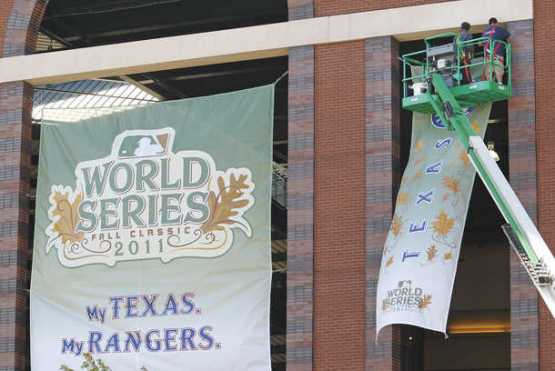 Banners being hung outside the ballpark (Photo: Fort Worth Star-Telegram)