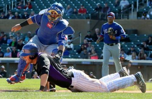 Things haven't been too graceful for Geovanny Soto and the Rangers this spring. (Photo credit to Louis Deluca/Dallas Morning News)