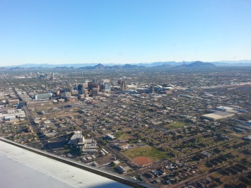 Downtown Phoenix from the descent. Chase Field sits right downtown with mountains lining the background.
