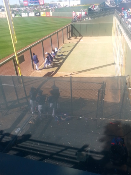 The Rangers bullpen is down the right field line. Under the screen you can see 2013 RoughRiders Randy Henry, Jimmy Reyes and Brett Nicholas.