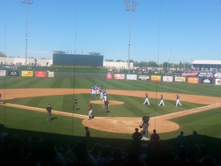 The Rangers assume the victory formation after an 8-2 win over the Reds.