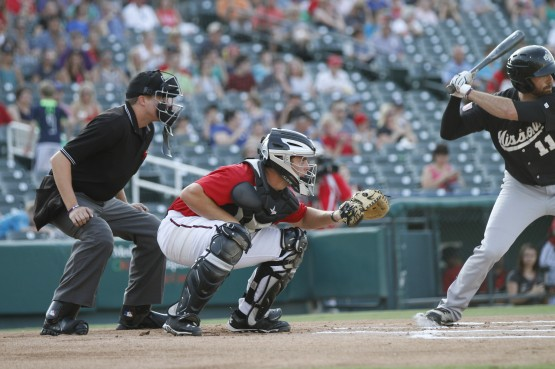 J.T. Wise behind the plate with Frisco.